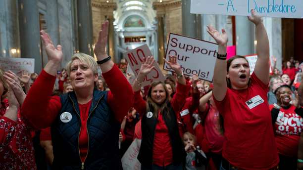 A group of the several hundred teachers gathered to protest perceived attacks on public education at the Capitol, in Frankfort, Ky, Tuesday, March 12, 2019. (AP Photo/Bryan Woolston)