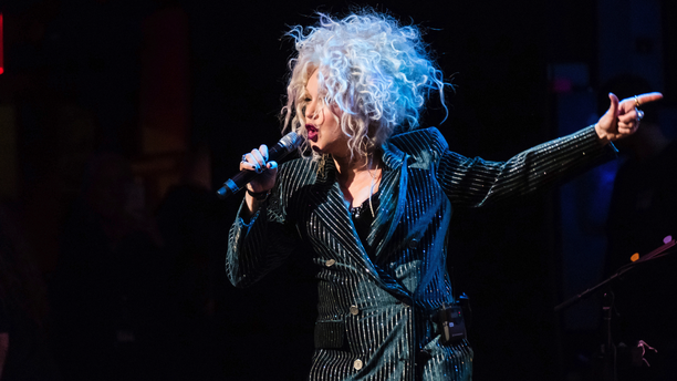 "FILE - In this Dec. 8, 2018 file photo, Cyndi Lauper performs at the 8th annual ""Home for the Holidays"" benefit concert at the Beacon Theatre in New York. A university in Vermont has announced Lauper will return to the school to give its commencement address.  Northern Vermont University-Johnson said Lauper will deliver the address May 18, 2019.  (Photo by Charles Sykes/Invision/AP, File)"