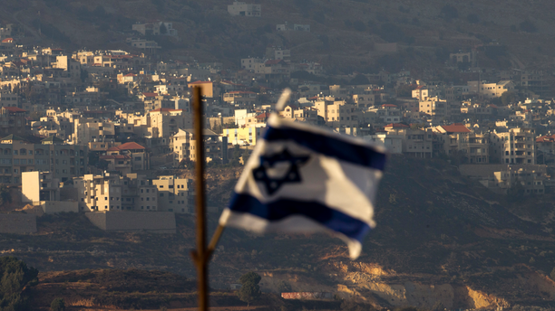 "FILE - In this file photo dated Thursday, Oct. 11, 2018, an Israeli flag in front of the village of Majdal Shams in the Israeli-controlled Golan Heights. Syria slammed President Donald Trump's abrupt declaration that Washington will recognise Israel's sovereignty over the Israeli-occupied Golan Heights, saying Friday March 22, 2019, the statement was ""irresponsible"" and a threat to international peace and stability. (AP Photo/Ariel Schalit, FILE)"