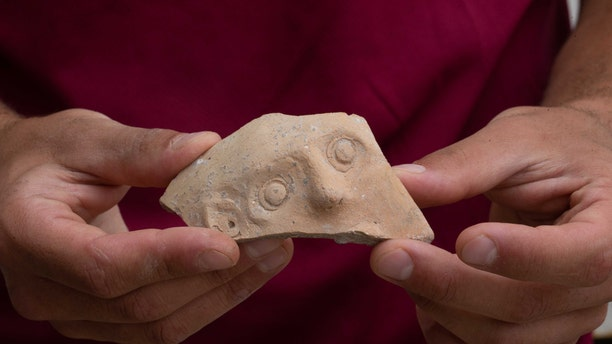 """The fragment is part of a jar known as a """"Bes-vessel."""" (Eliyahu Yanai, City of David)"""