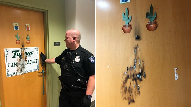 A responding officer assesses the damage after the alleged targeted arson attack on Tulane campus.