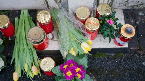 Flowers are set at a house of a doctor, who died in an explosion by a booby trap in Enkenbach-Alsenborn, Germany, Tuesday, March 5, 2019. A gardener, who was found also dead, is suspected to have set the booby trap.