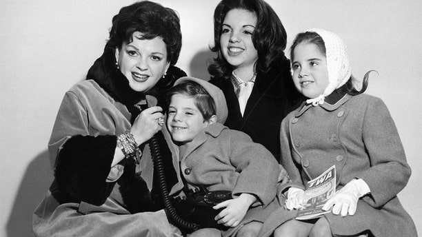 Judy Garland pictured in New York on arrival with her family, from London, en route to Miami where she will earn an all time record salary of $10,000 for a one night stand. Mrs. Garland, wife of producer Sid Luft, arrived with her three children Liza, 14; Lorna, 8; and Joey, 5. Undated.