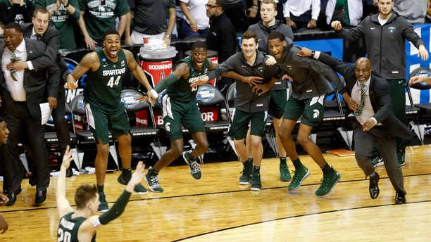 Michigan State players begin to celebrate their win over Duke at the end of the NCAA men's East Regional final college basketball game in Washington, Sunday, March 31, 2019. (AP Photo}