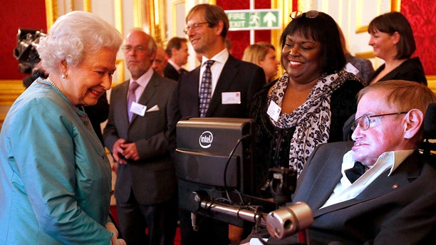 Queen Elizabeth II meets Professor Stephen Hawking (R) during a reception for Leonard Cheshire Disability in the State Rooms, St James's Palace on May 29, 2014 in London. Hawking is accompanied by Patricia Dowdy.