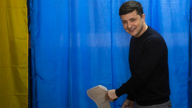 Ukrainian comedian and presidential candidate Volodymyr Zelenskiy holding his ballot before voting in the presidential elections in Kiev, Ukraine, on Sunday. (AP Photo/Emilio Morenatti)