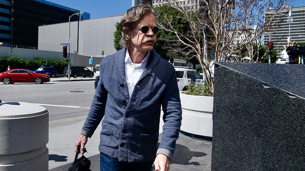 Actor William H. Macy arrives at the federal courthouse in Los Angeles, on Tuesday. Macy was not charged; authorities did not say why.