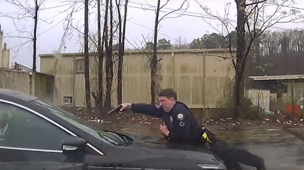 Officer Charles Starks can be seen the car's hood shooting at 30-year-old Bradley Blackshire through the windshield as Blackshire continues to drive.