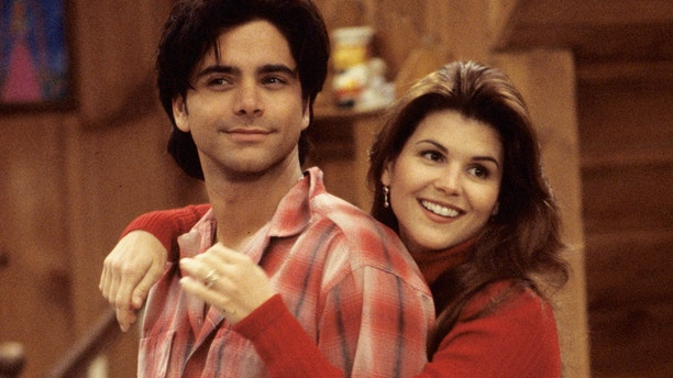 """John Stamos as Uncle Jesse and Lori Loughlin as Aunt Becky in an episode of """"Full House."""""""