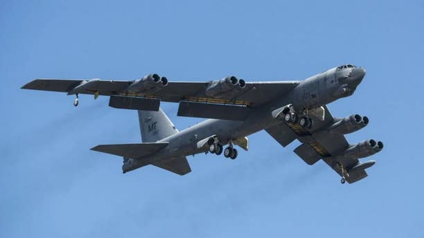 A B-52H Stratofortress takes off.