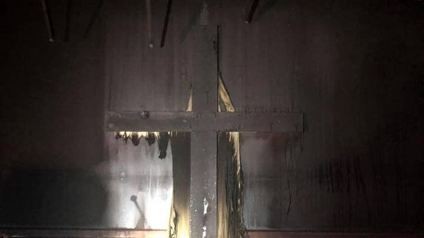 Firefighters in West Virginia say the crosses in a church fire were not harmed.