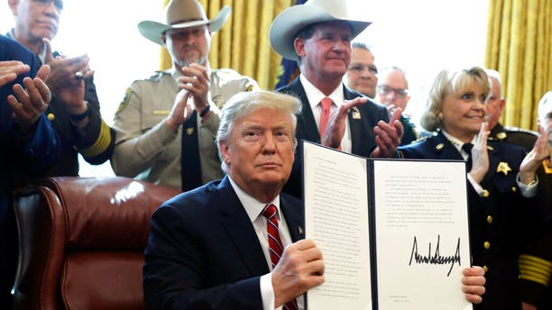President Donald Trump speaks about border security in the Oval Office of the White House, Friday, March 15, 2019, in Washington. Trump issued the first veto of his presidency, overruling Congress to protect his emergency declaration for border wall funding. (AP Photo/Evan Vucci)