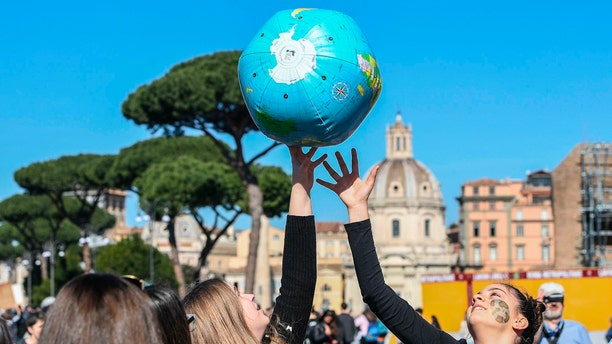 Students play with an inflatable globe as they march to demand action on climate change, in Rome, Friday. (Alessandro Di Meo/ANSA via AP)