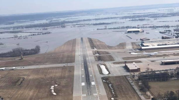 The runway at Offutt Air Force Base can be seen covered by floodwaters from the Missouri River.