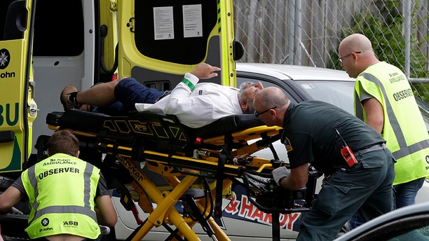 Ambulance staff provide aid to a man following the attacks in Christchurch, New Zealand on Friday.