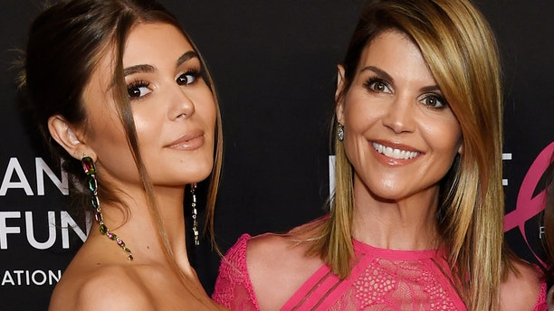 Actress Lori Loughlin poses with her daughter Oliva Jade Giannulli, who are both embattled in the ongoing college admissions scandal.