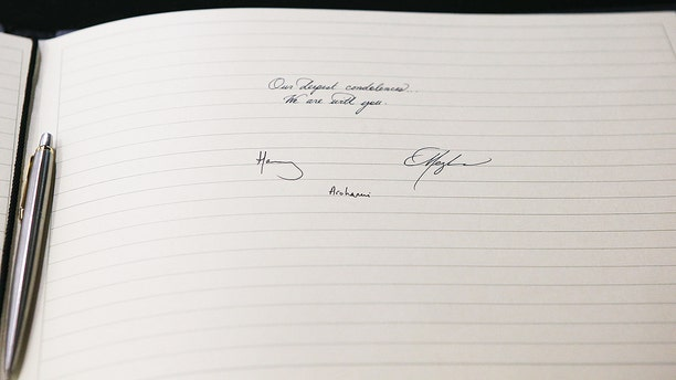 Meghan, Duchess of Sussex and Prince Harry, Duke of Sussex sign a book of condolence on behalf of The Royal Family at New Zealand House on March 19, 2019 in London, England. The visit was following the recent terror attack which saw at least 50 people killed at a Mosque in Christchurch.
