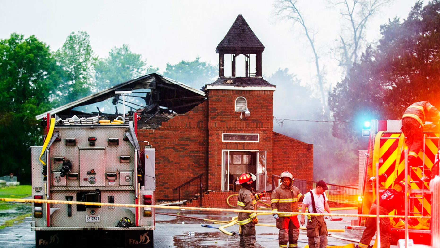 FILE: Firefighters and fire investigators responding to a fire at Mt. Pleasant Baptist Church Thursday, April 4, 2019, in Opelousas, La.