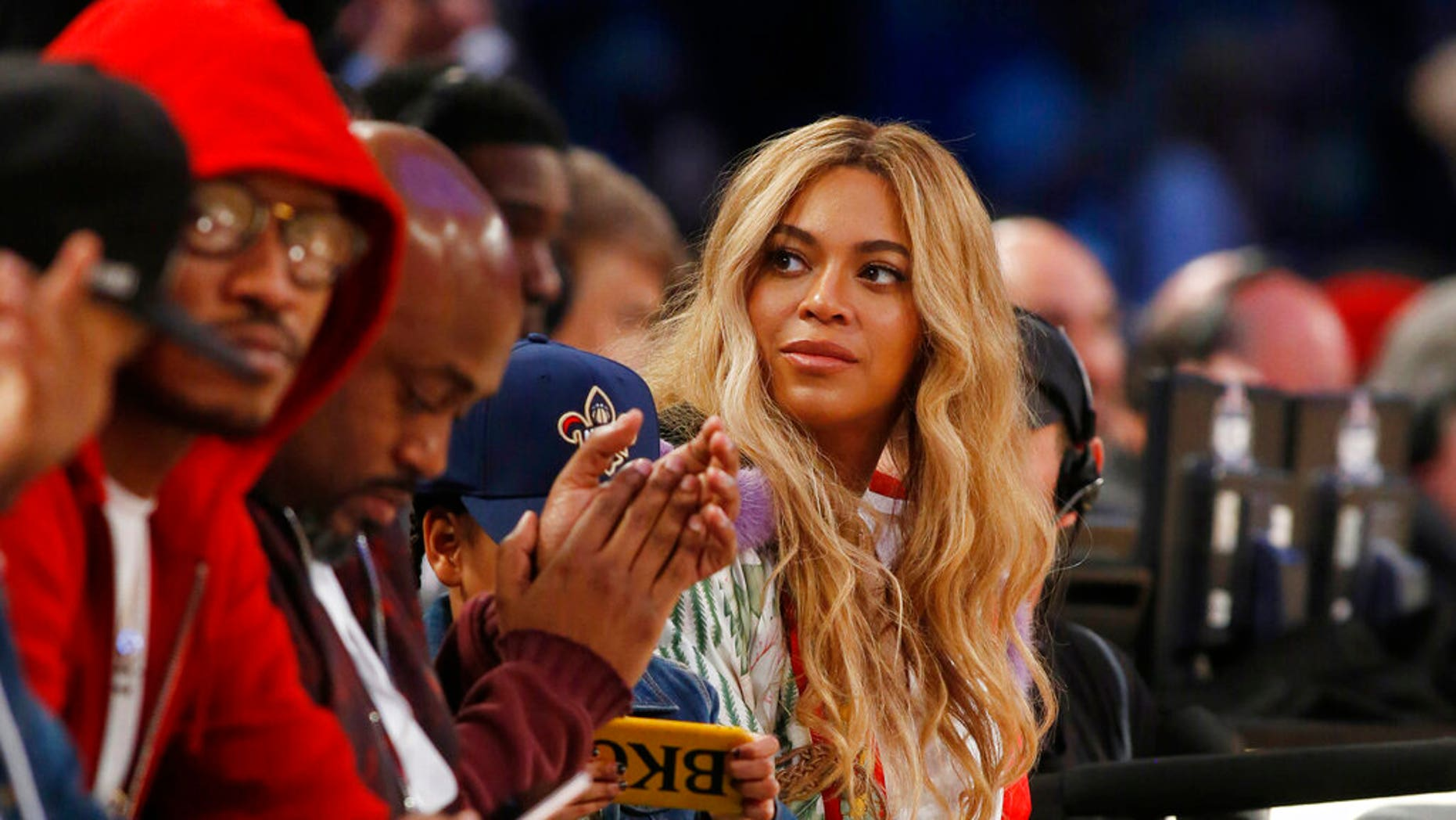 FILE: Beyonce sits at court side during the second half of the NBA All-Star basketball game in New Orleans.