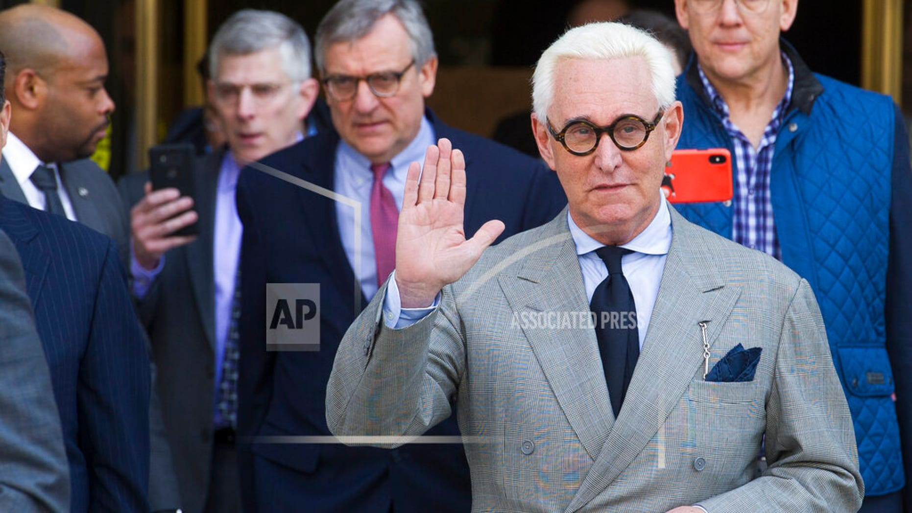 In this Thursday, March 14 photo, Roger Stone, an associate of President Trump, leaves U.S. District Court after a court status conference. On Friday, Stone asked a federal judge to compel the Justice Department to turn over a full copy of Special Counsel Robert Mueller's report on the Russia investigation as part of discovery in his criminal case. (AP Photo/Cliff Owen, File)