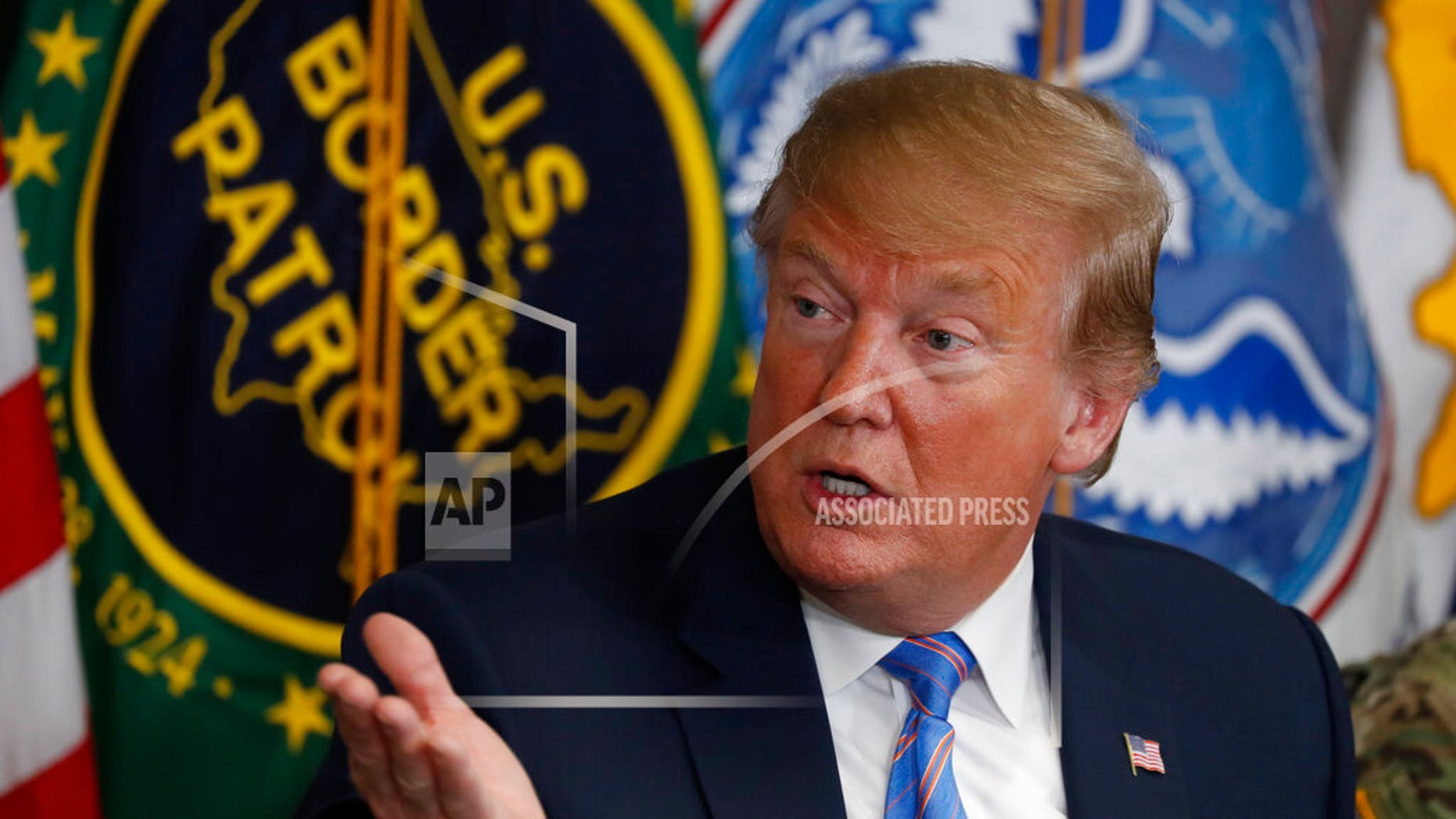 """In this April 5 photo, President Donald Trump participates in a roundtable on immigration and border security at the U.S. Border Patrol Calexico Station in Calexico, Calif. Trump said Friday he is considering sending """"Illegal Immigrants"""" to Democratic strongholds to punish them for inaction. (AP Photo/Jacquelyn Martin)"""