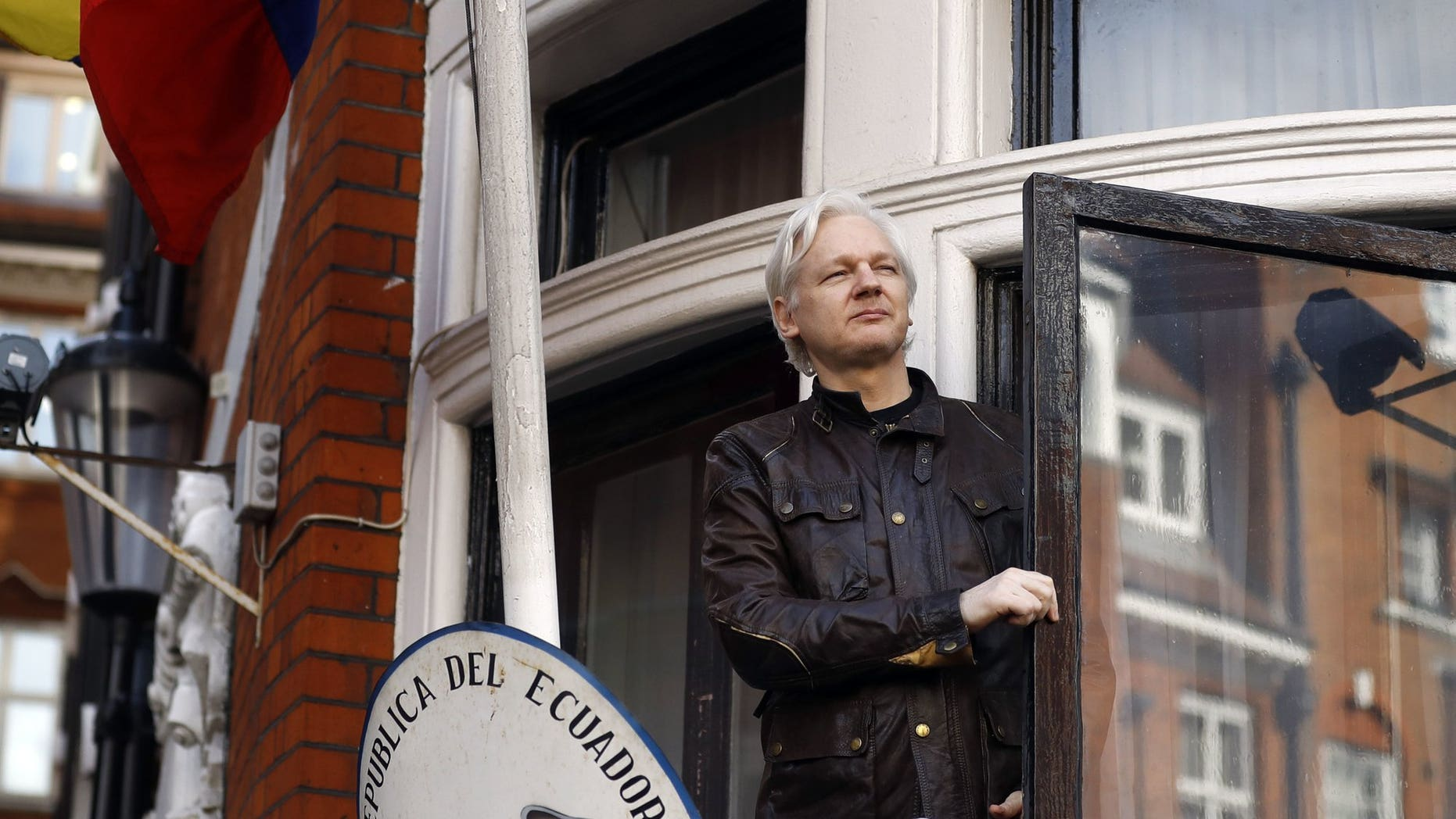 WikiLeaks founder Julian Assange greets supporters outside the Ecuadorian Embassy in London, May 19, 2017. (Associated Press)