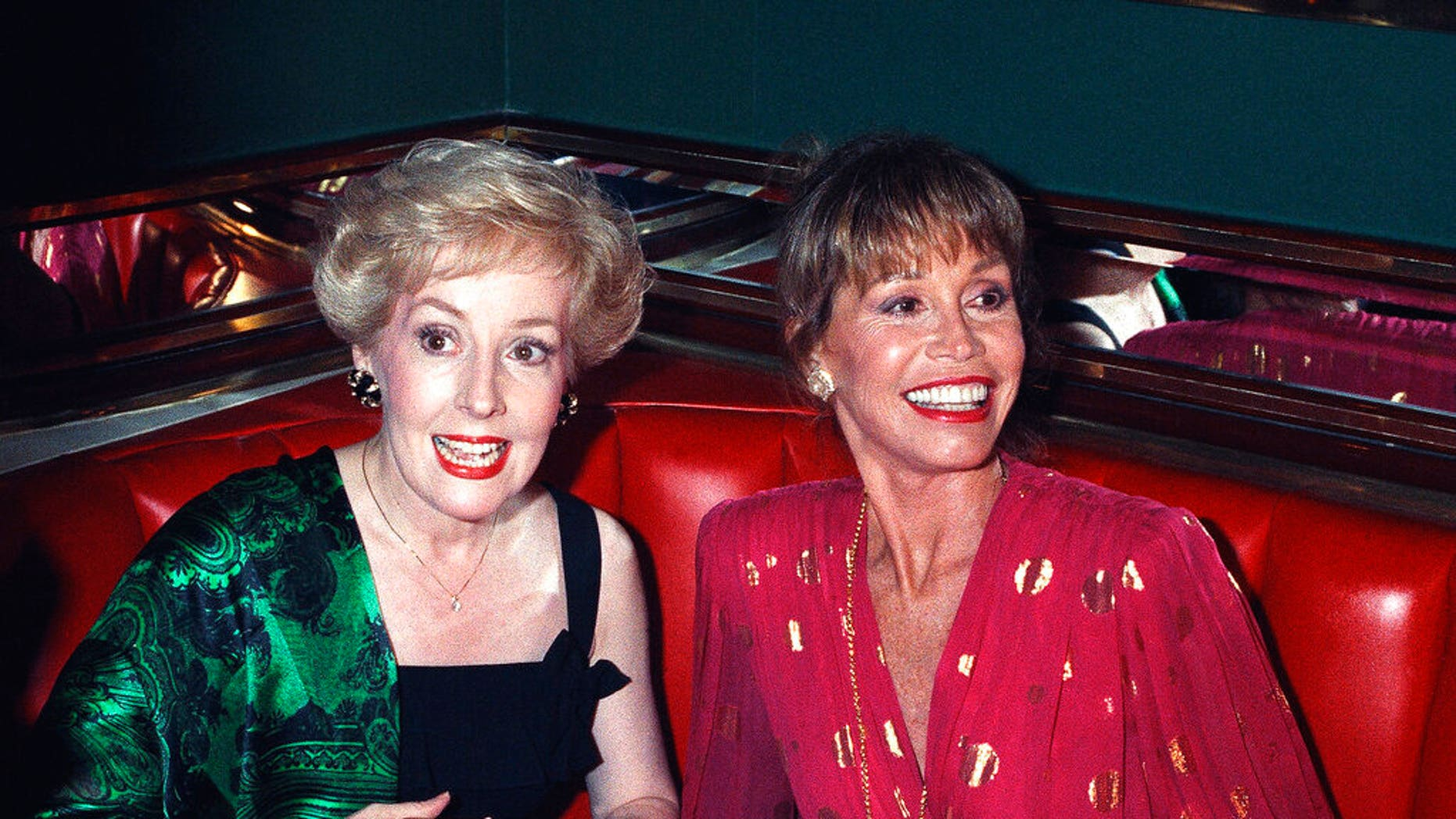 "FILE: Mary Tyler Moore, right, is joined by former ""Mary Tyler Moore Show"" co-star Georgia Engel, left, at New York's Russian Tea Room at an Emmy Awards screening party in 1992."