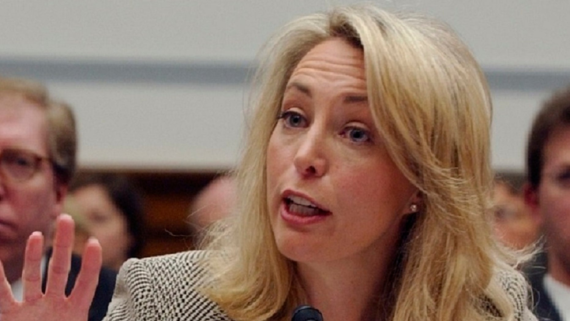 Former CIA operative Valerie Plame gestures while testifying on Capitol Hill, in an undated photo. (Associated Press)