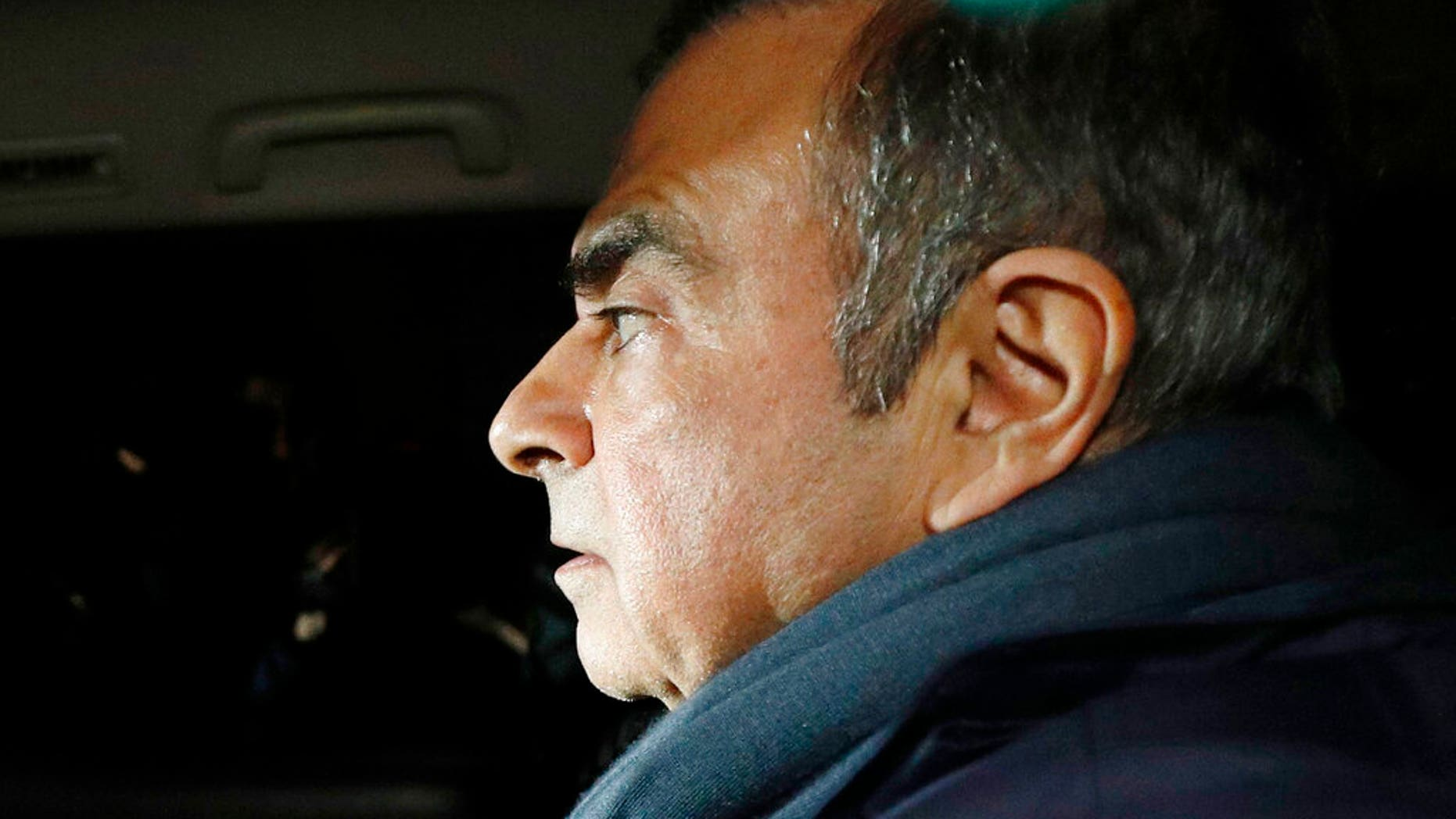 Former Nissan Chairman Carlos Ghosn in a car leaves his lawyer's office in Tokyo.