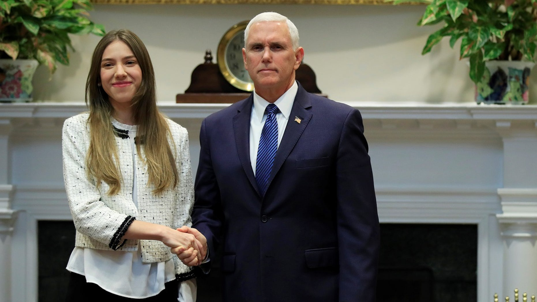 Vice President Mike Pence welcomes Fabiana Rosales, left, wife of Venezuelan opposition leader Juan Guaido, in the Roosevelt Room of the White House in Washington, Tuesday, March 26, 2019. (Associated Press)