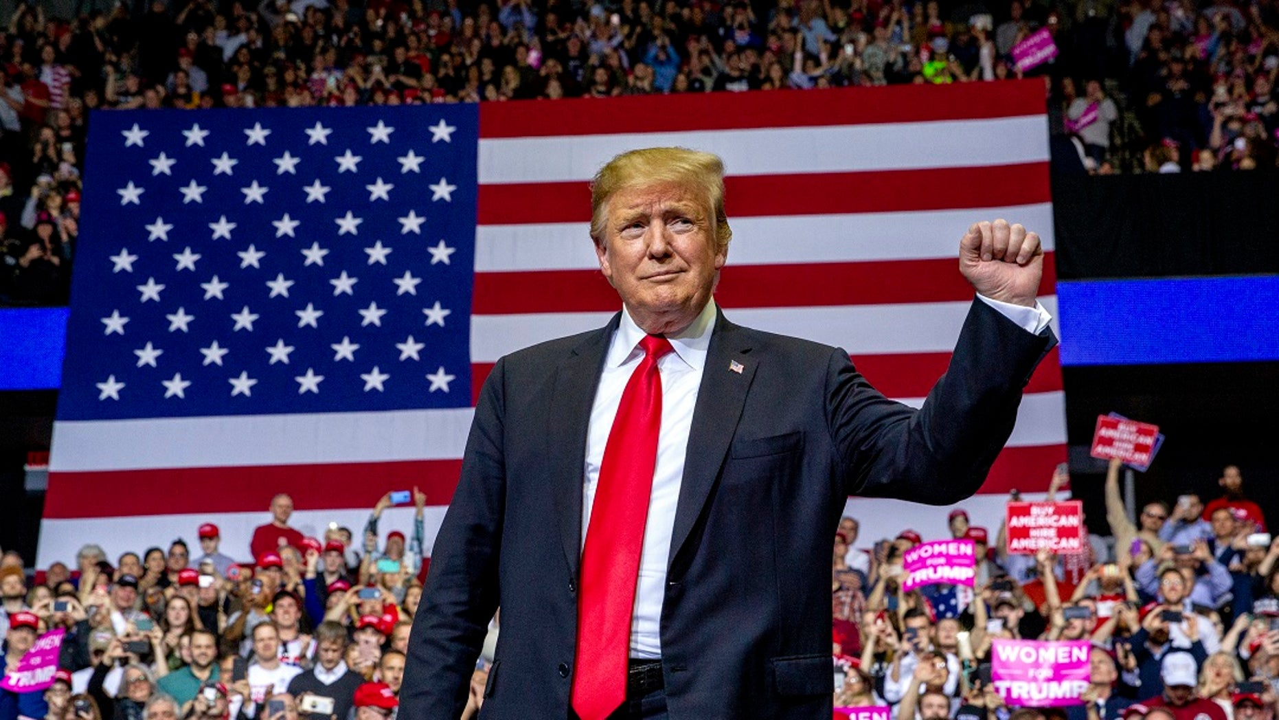 President Donald Trump gestures at a campaign rally at Van Andel Arena in Grand Rapids, Mich., on Thursday, March 28, 2019. (Cory Morse/MLive.com/The Grand Rapids Press via AP)