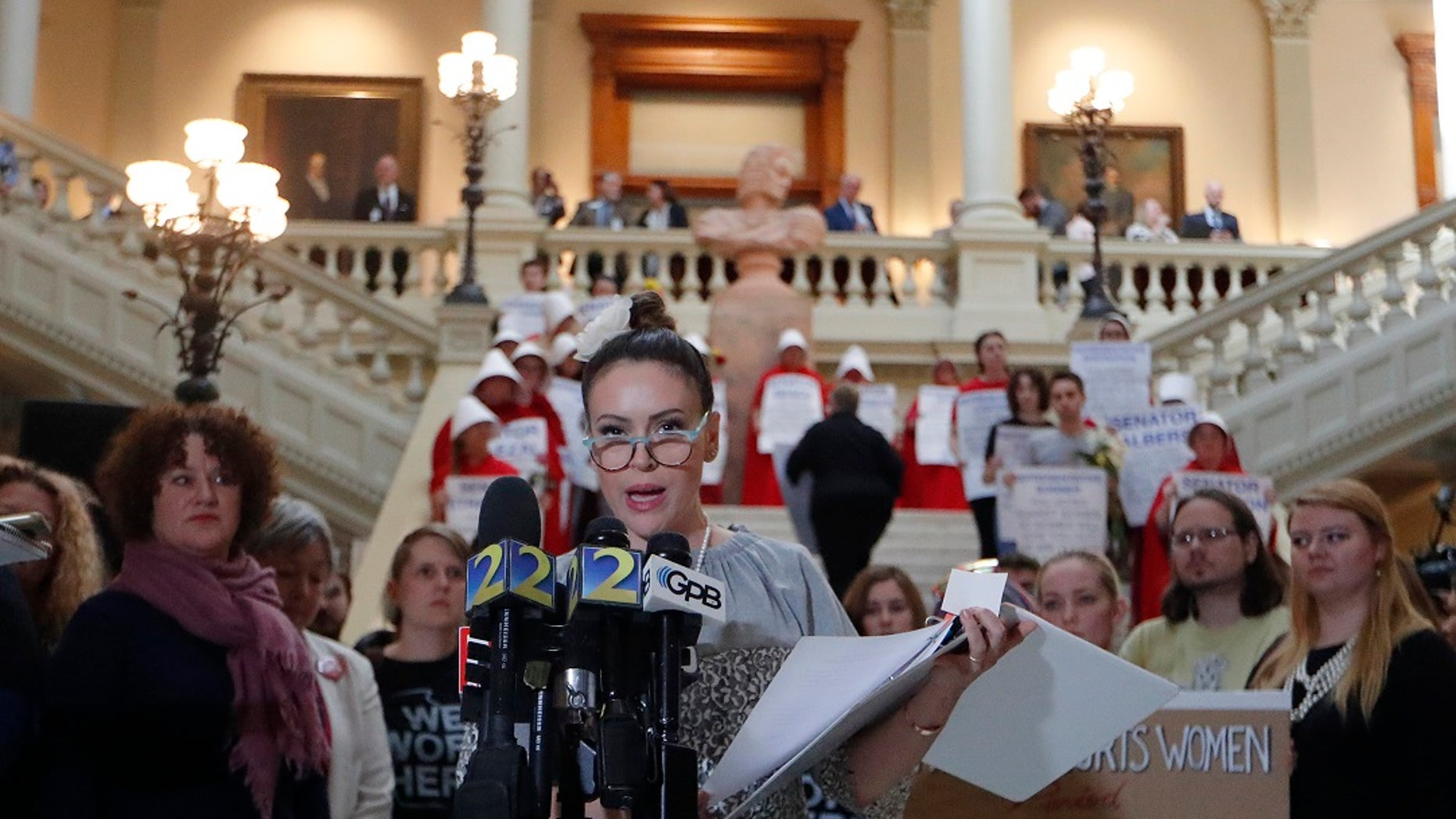 Actress Alyssa Milano speaks after delivering a letter to Georgia Gov. Brian Kemp's office detailing her opposition to HB 481 at the State Capitol, Tuesday, April 2, 2019, in Atlanta. HB 481 would ban almost all abortions after a fetal heartbeat can be detected.