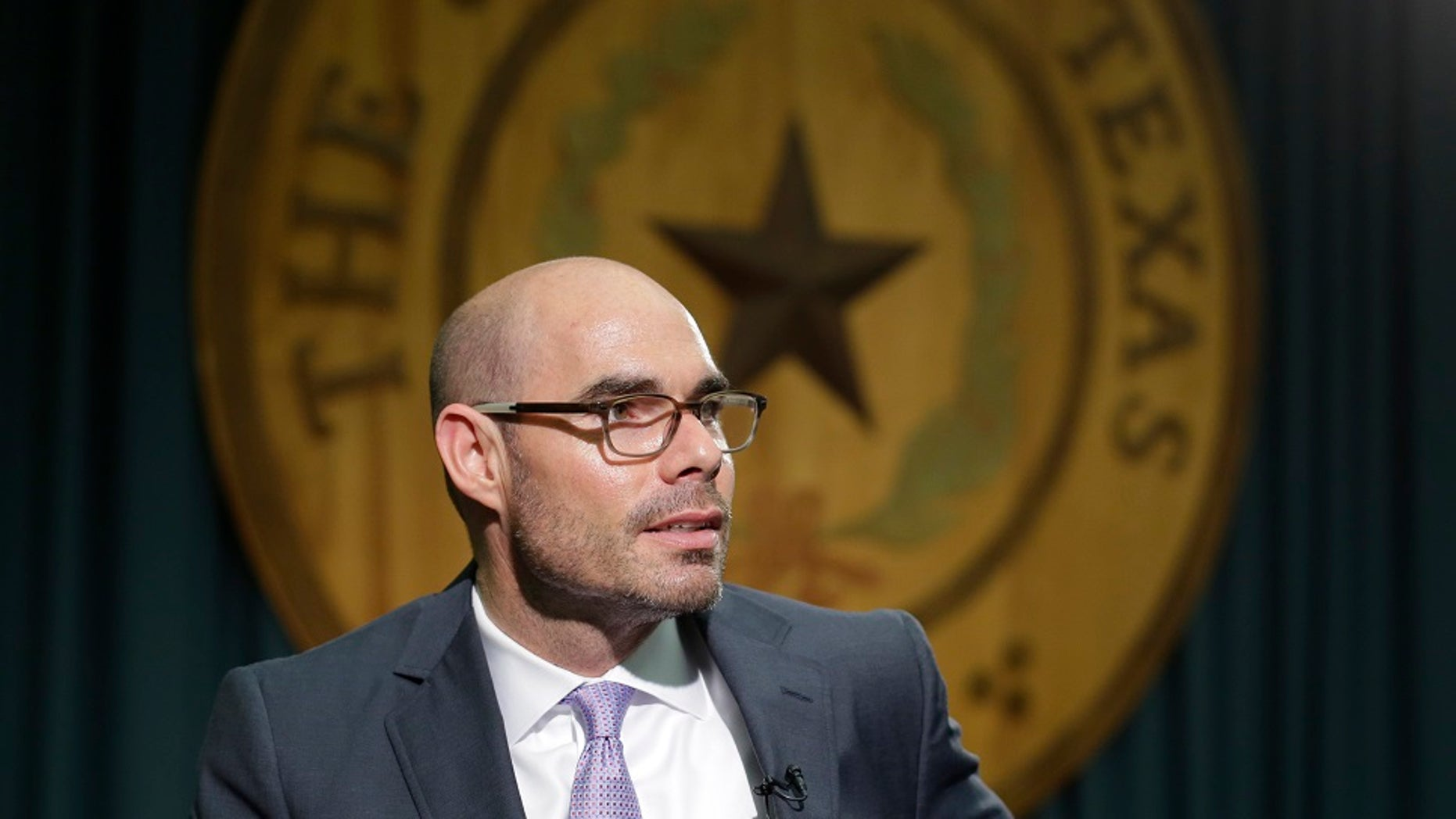 Texas Rep. Dennis Bonnen, R-Angleton, talks to the media at the Texas Capitol in Austin, Texas. A Texas gun rights activist drove to the homes of Republican legislators he blamed for stalling proposals to expand gun laws, prompting state troopers to monitor Bonnen's, the now House speaker, family residence. (Associated Press)