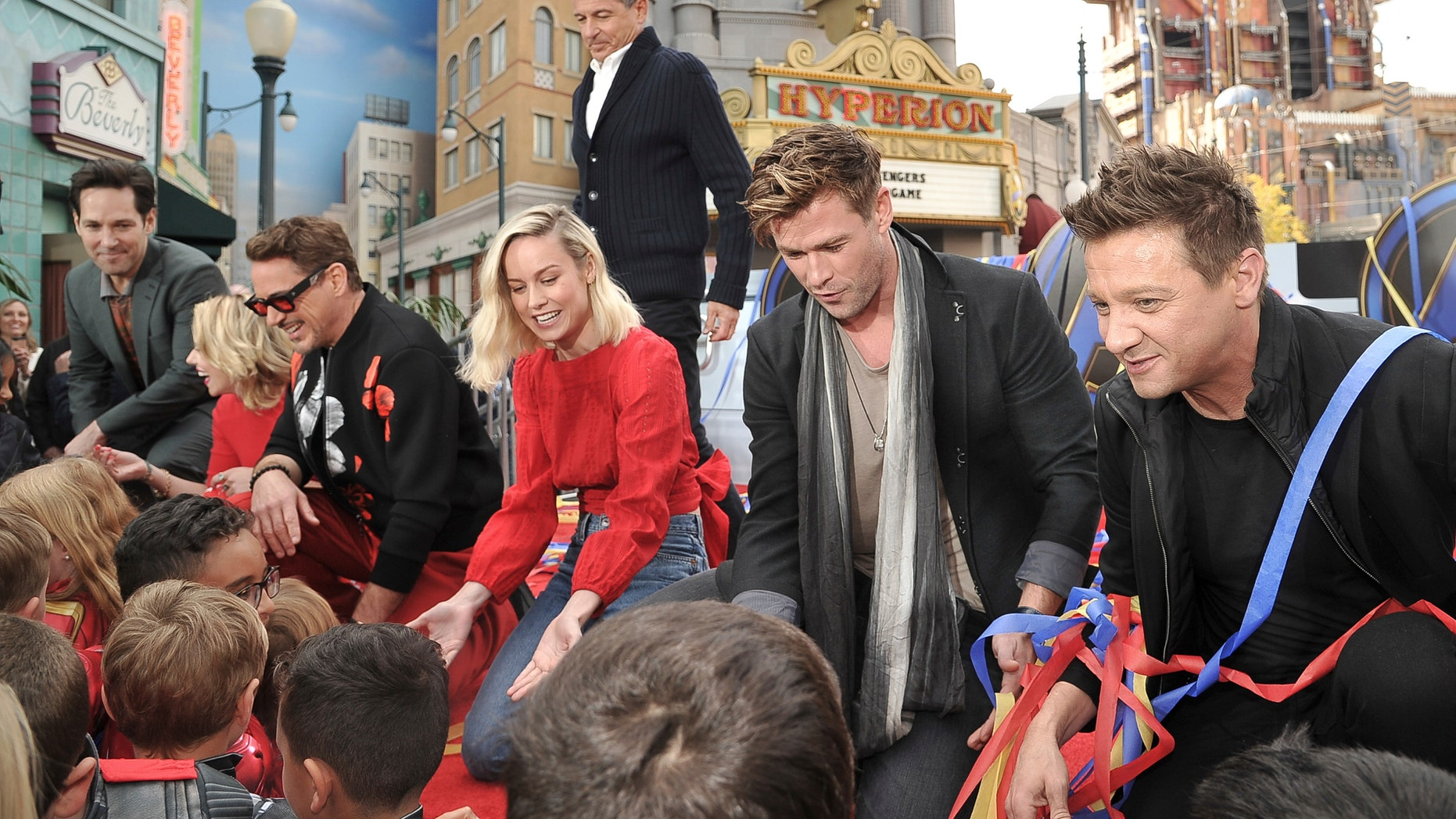 """""""Avengers: Endgame"""" cast members Paul Rudd, left, Scarlett Johansson, Robert Downey Jr., Brie Larson, Chris Hemsworth and Jeremy Renner appear with Disney CEO Robert Iger, background center, at an event announcing the Universe Unites Charity at Disney California Adventure Park on Friday in Anaheim, Calif."""