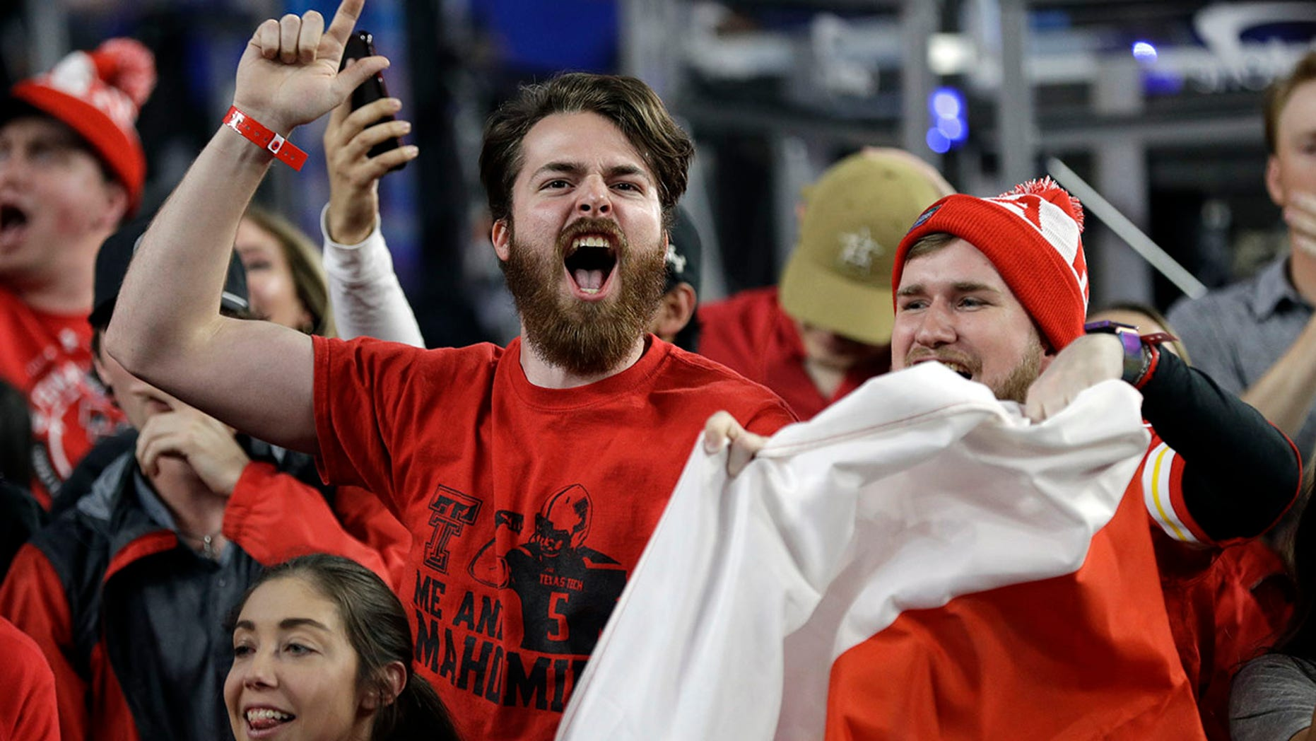 """Texas Tech fans cheer before the semifinals of the Final Four NCAA college basketball tournament against Michigan State, Saturday, April 6, 201<div class=""""e3lan e3lan-in-post1""""><script async src=""""//pagead2.googlesyndication.com/pagead/js/adsbygoogle.js""""></script> <!-- Text_Image --> <ins class=""""adsbygoogle""""      style=""""display:block""""      data-ad-client=""""ca-pub-6192903739091894""""      data-ad-slot=""""3136787391""""      data-ad-format=""""auto""""      data-full-width-responsive=""""true""""></ins> <script> (adsbygoogle = window.adsbygoogle 