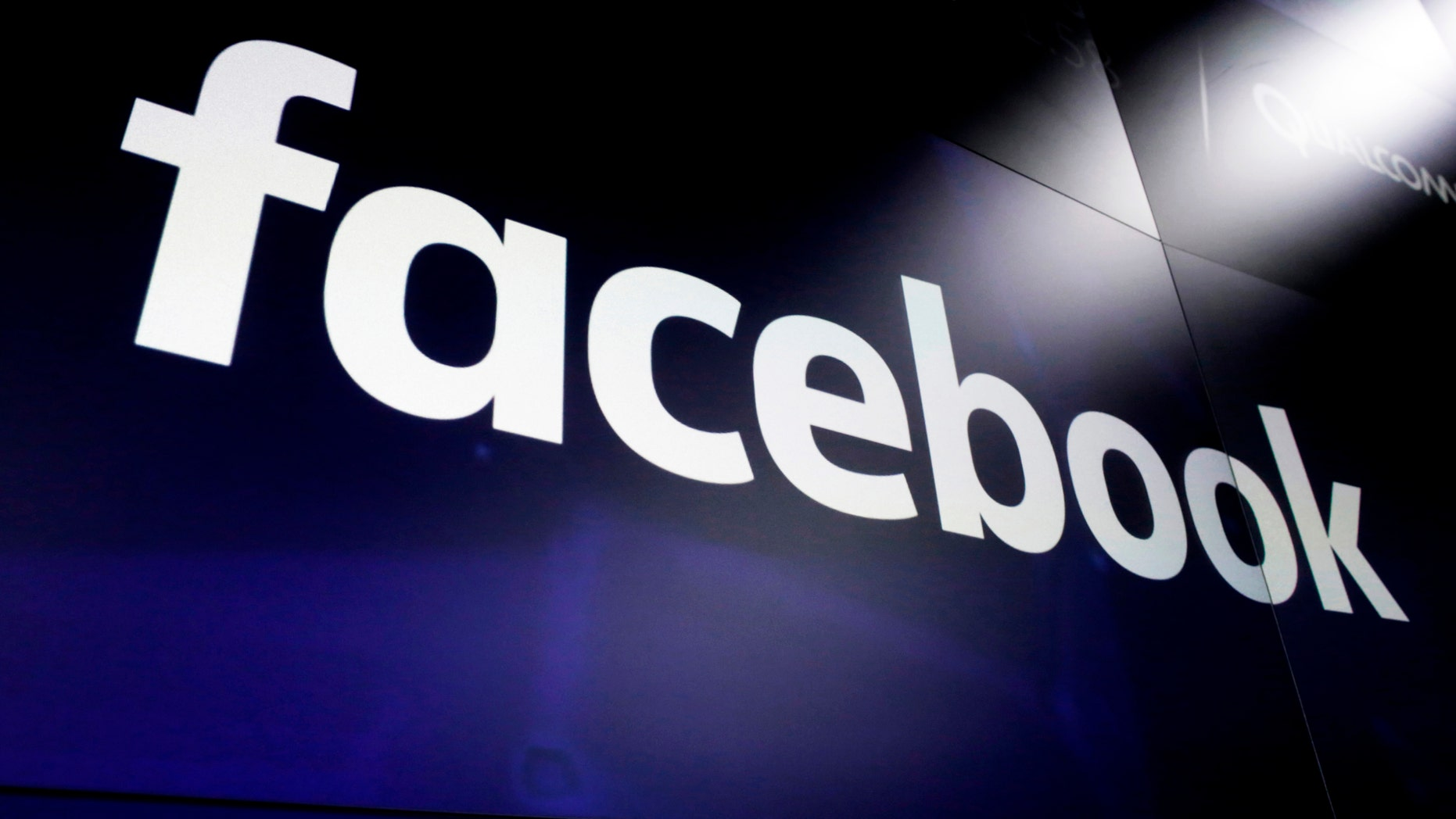 FILE - In this March 29, 2018, file photo the logo for social media giant Facebook, appears on screens at the Nasdaq MarketSite, in New York's Times Square.  (AP Photo/Richard Drew, File)