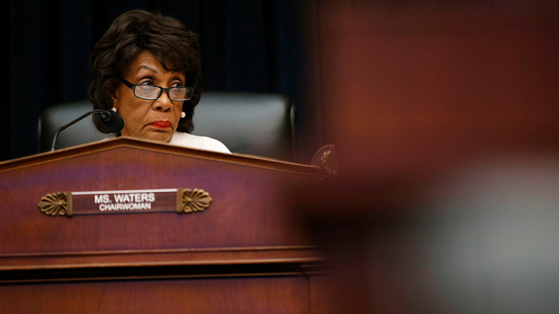 House Financial Services Committee chairwoman Maxine Waters, D-Calif., listens during a hearing with leaders of major banks, Wednesday, April 10, 2019, on Capitol Hill in Washington.