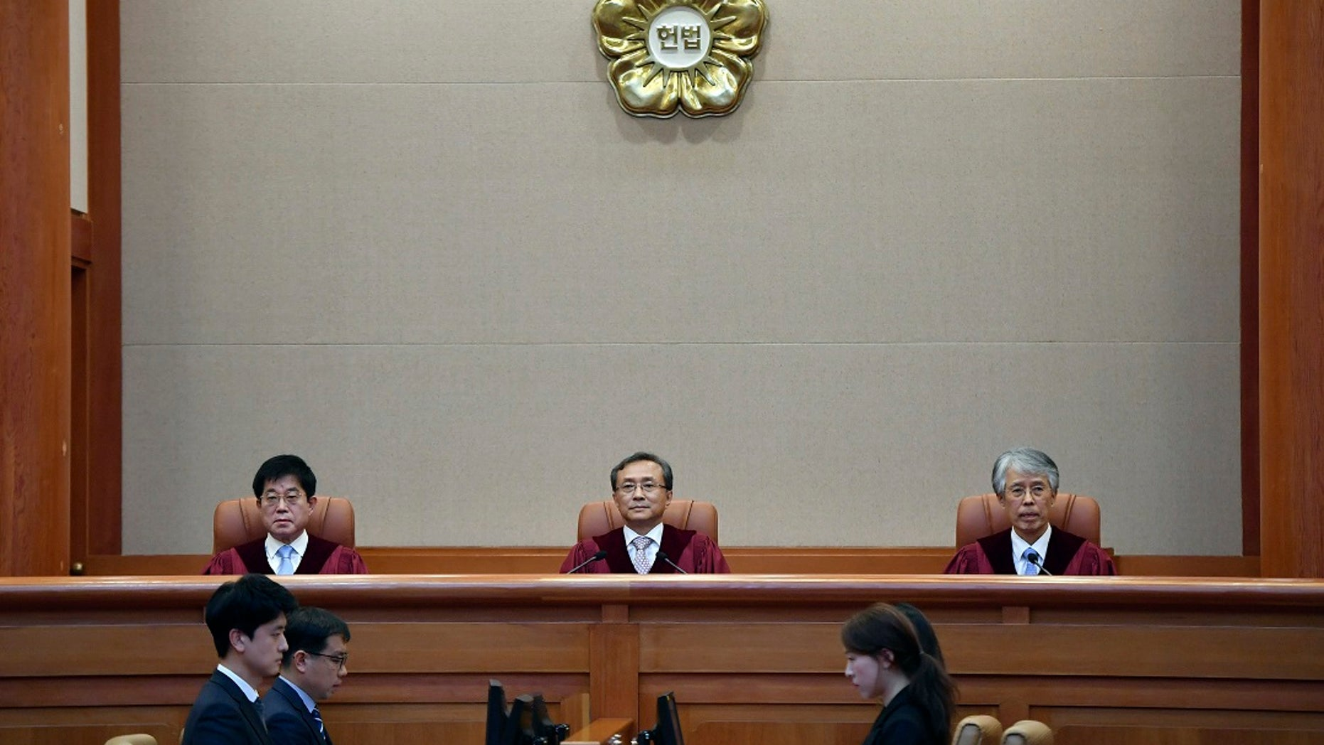 South Korea's Constitutional Court chief judge Yoo Nam-seok, center, and other judges sit for the ruling on decriminalization of abortion at the court in Seoul on Thursday. (Jung Yeon-je /Pool Photo via AP)