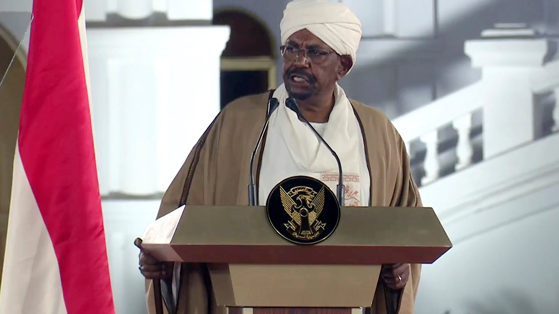 FILE - In this file image taken from video, Sudan's President Omar al-Bashir speaks at the Presidential Palace, Friday, Feb. 22, 2019, in Khartoum, Sudan. Tens of thousands of Sudanese were making their way to the center of the country's capital on Thursday, April 11, 2019, cheering and clapping in celebration as two senior officials said the military had forced longtime autocratic President Omar al-Bashir to step down after 30 years in power.(AP Photo/Mohamed Abuamrain, File)