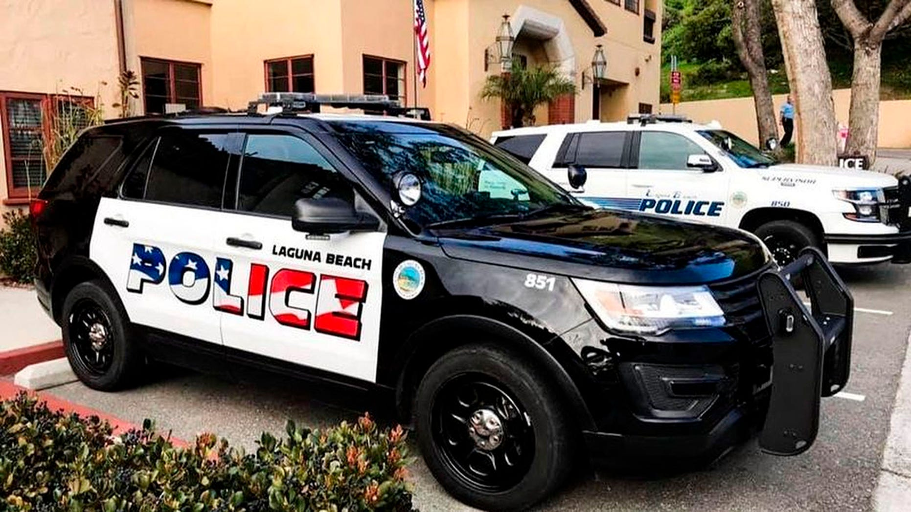 This undated photo of the Laguna Beach Police Station shows their newly decorated SUV police patrol vehicles in Laguna Beach, California. Seven of the department's eleven vehicles have already been painted, the department said in a text to The Los Angeles Times.