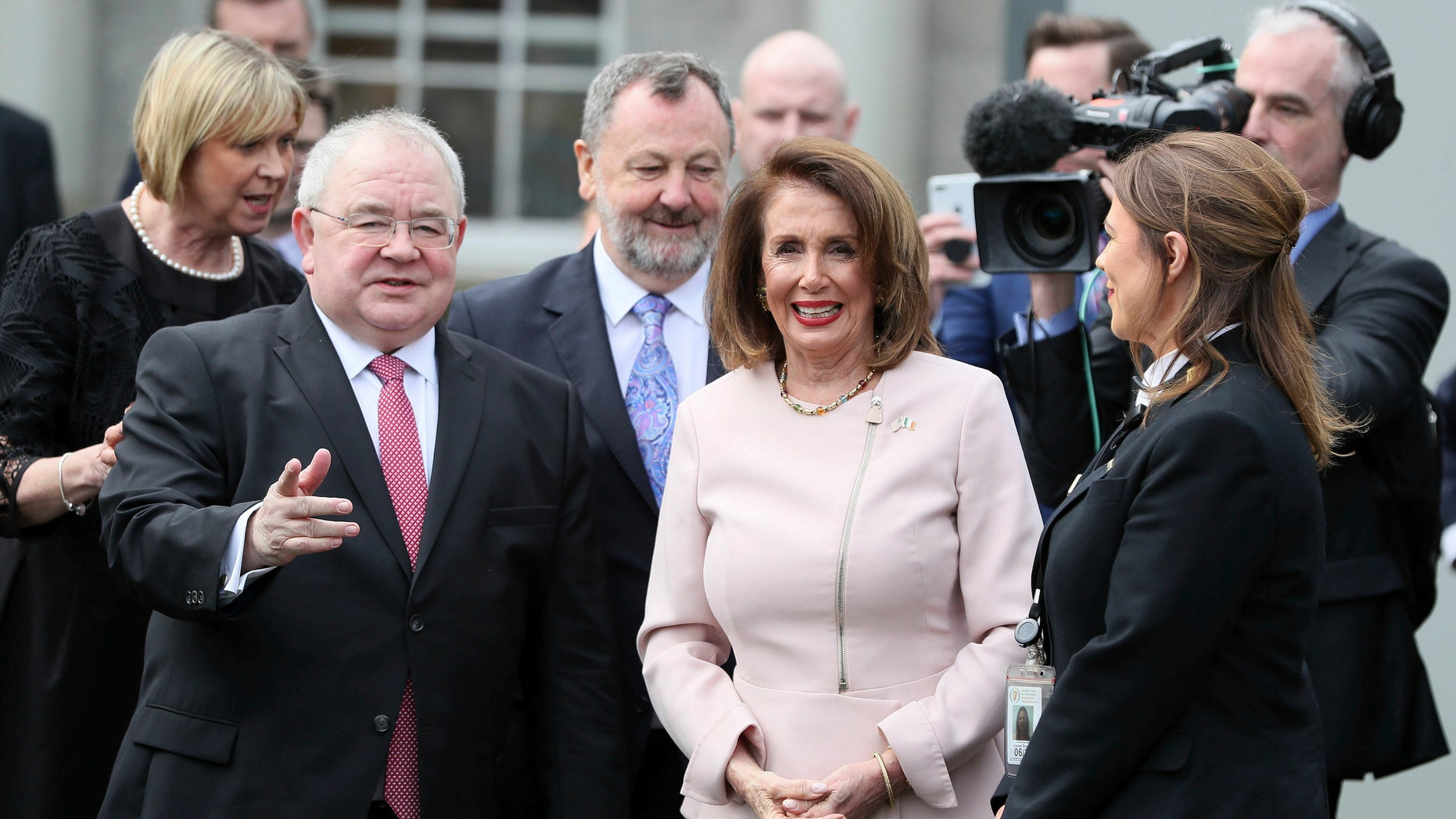 US House of Representatives speaker Nancy Pelosi is greeted by Chairperson of the lower house of parliament Sean O Fearghail, left, on arrival at Leinster House in Dublin to deliver an address in Dublin, Ireland, Wednesday April 17, 2019. (Brian Lawless, via AP)