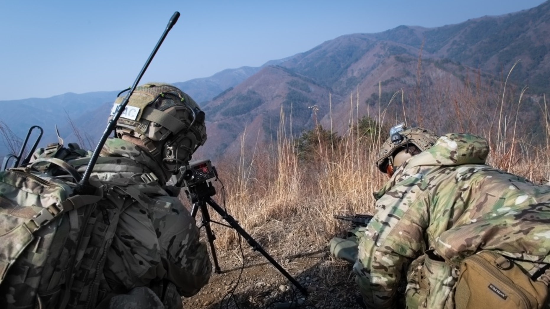 File photo - Two U.S. Air Force joint terminal attack controllers utilize a laser designator designed to designate a target during training at Pilsung Range in Gangwan Province, Republic of Korea, Feb. 14, 2019. (U.S. Air Force photo by Staff Sgt. Benjamin Raughton)