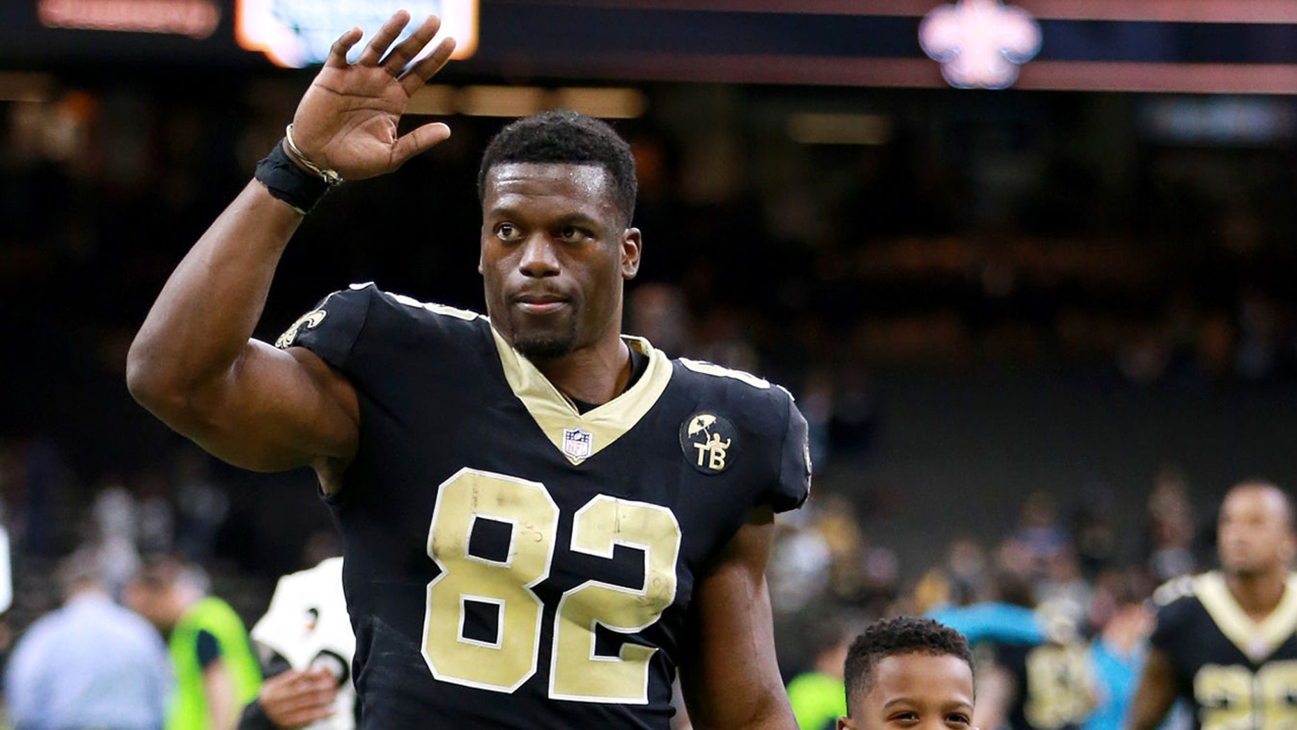 Benjamin Watson, #82 of a New Orleans Saints, walks off a margin with his son after NFL diversion opposite a Carolina Panthers during a Mercedes-Benz Superdome in New Orleans, Louisiana on Dec 30, 2018. (Photo by Sean Gardner/Getty Images)