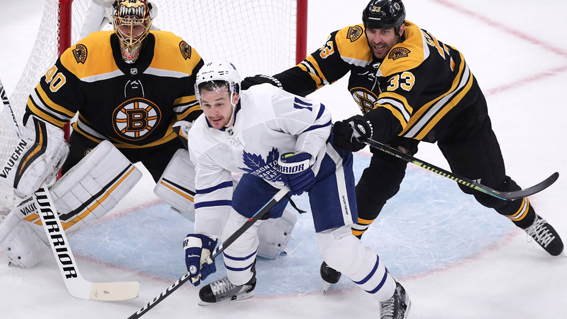 Boston Bruins defenseman Zdeno Chara (33) tries to clear Toronto Maple Leafs left wing Zach Hyman (11) away from goalie Tuukka Rask during the first period of Game 7 of an NHL hockey first-round playoff series, Tuesday, April 23, 2019, in Boston. (Associated Press)