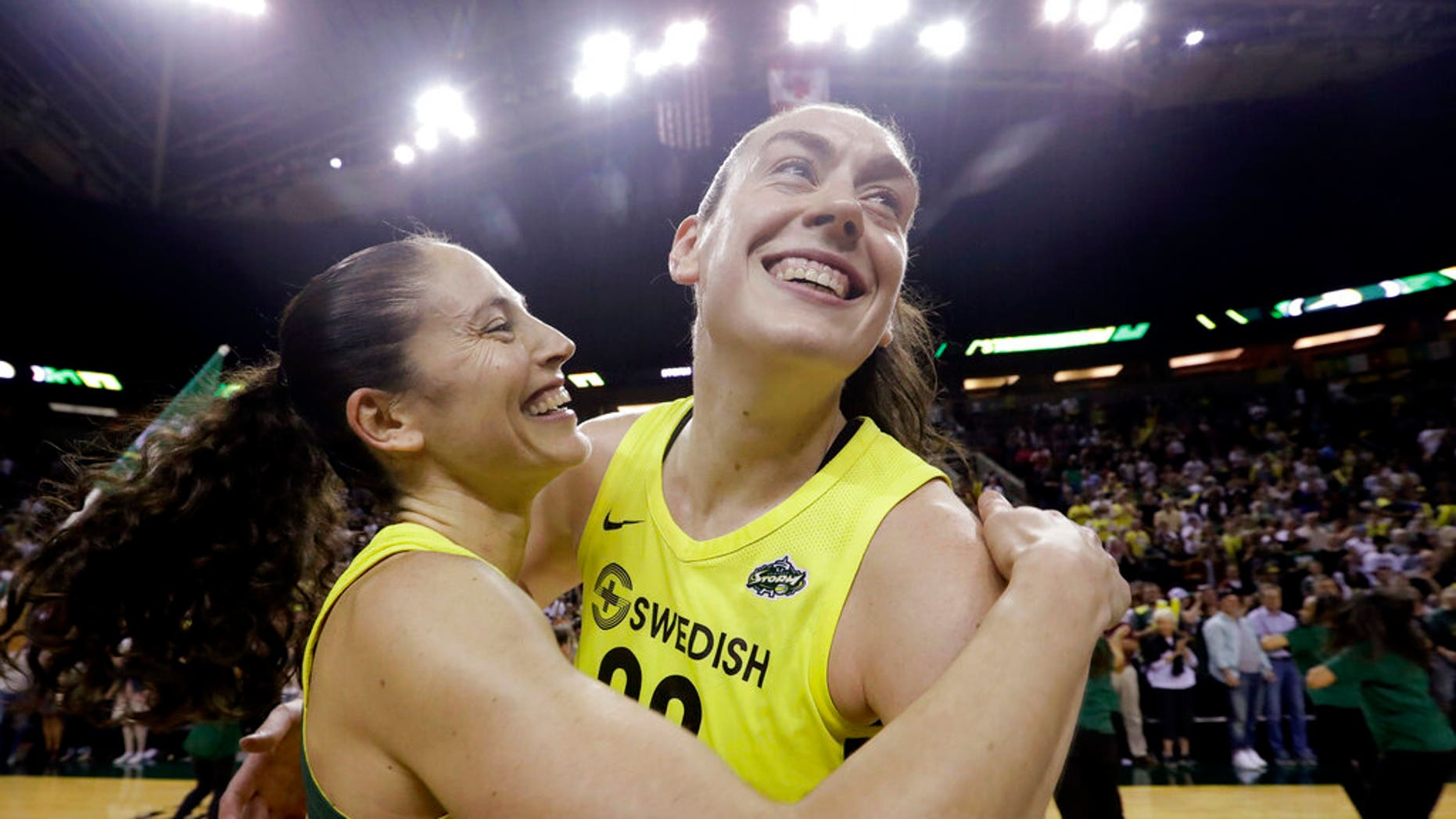 FILE - In this Sept. 4, 2018, file photo, Seattle Storm's Breanna Stewart, right, is embraced by Sue Bird after the Storm defeated the Phoenix Mercury 94-84 during Game 5 of a WNBA basketball playoff semifinal, in Seattle. The WNBA's 23rd season begins May 24, with the Seattle Storm the defending champion. (AP Photo/Elaine Thompson, File)