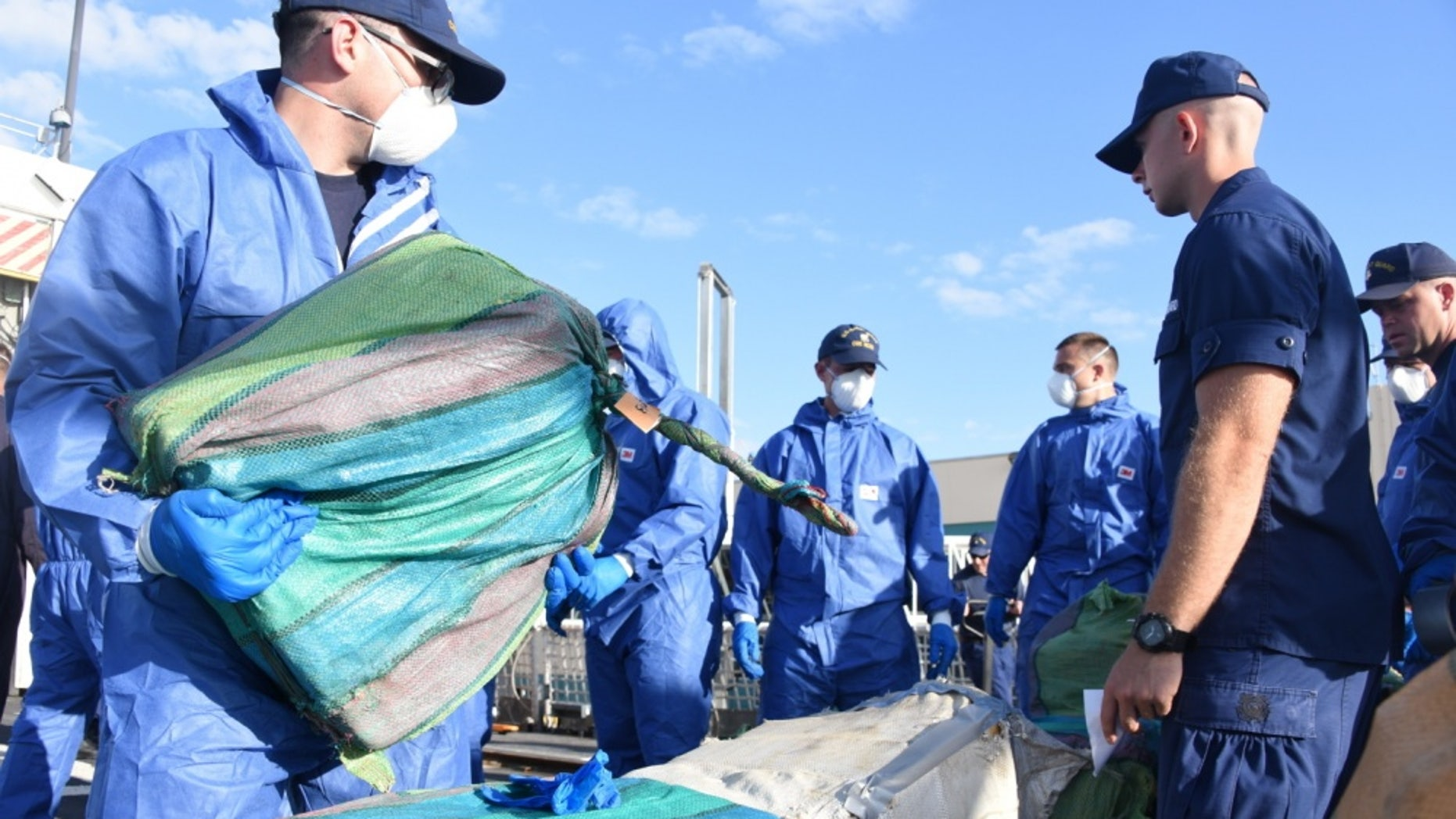 Crewmembers of the Coast Guard Cutter Bear handle drugs intercepted off the coasts of Mexico, Central and South America. Photo by Petty Officer 3rd Class Brandon Murray.