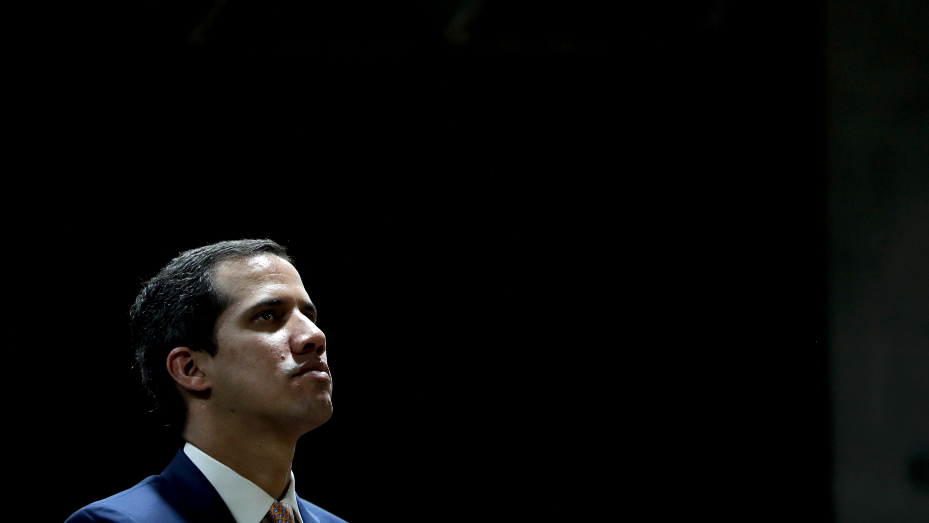 "Juan Guaido, Venezuelan opposition leader and self-proclaimed interim president, attends a meeting at a university in Caracas, Venezuela, Monday, April 1, 2019. He's backed by more than 50 nations, which consider Nicolas Maduro's presidency illegitimate following what they call sham elections last year. ""We must unite now more than ever,"" said Guaido, speaking at the university. ""We must mount the biggest demonstration so far to reject what's happening."" (AP Photo/Natacha Pisarenko)"