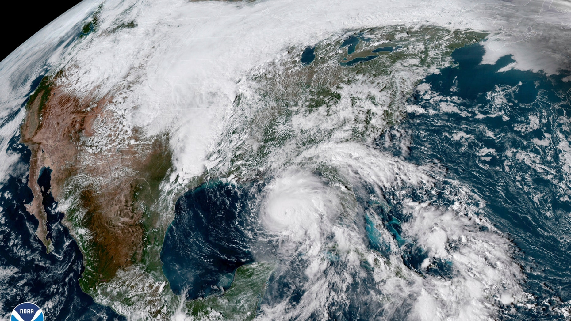 FILE - This Oct. 9, 2018, file photo shows a satellite image made available by NOAA showing Hurricane Michael, center, in the Gulf of Mexico. Hundreds of residents in the county hardest hit by Hurricane Michael are losing housing vouchers that allowed them to stay at hotels in the aftermath of the Category 4 storm. Around 250 households in Bay County, Florida, are facing eviction from hotels Tuesday, April 9, 2019 since their vouchers from the Federal Emergency Management Agency's Transitional Sheltering Assistance program were ending. (NOAA via AP, File)