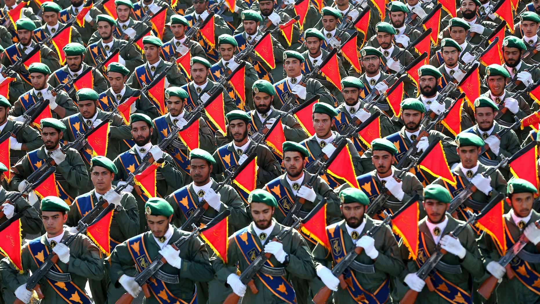 """FILE - In this Sept. 21, 2016 file photo, Iran's Revolutionary Guard troops march in a military parade marking the 36th anniversary of Iraq's 1980 invasion of Iran, in front of the shrine of late revolutionary founder Ayatollah Khomeini, just outside Tehran, Iran. The Trump administration is preparing to designate Iran's Revolutionary Guards Corps a """"foreign terrorist organization"""" in an unprecedented move that could have widespread implications for U.S. personnel and policy. U.S. Officials say an announcement could come as early as Monday, April 8, 2019, following a months-long escalation in the administration's rhetoric against Iran. The move would be the first such designation by any U.S. administration of an entire foreign government entity. (AP Photo/Ebrahim Noroozi, File)"""