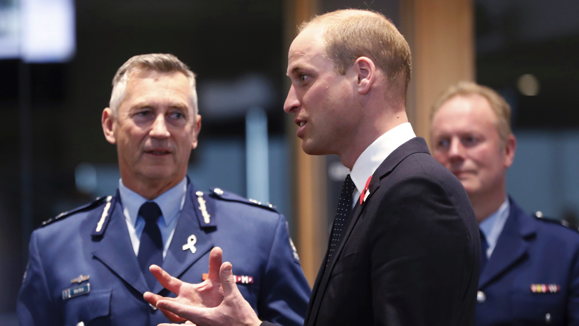 Britain's Prince William, center, meets with Police St. Johns ambulance staff during a visit to the Justice and Emergency Services Precinct in Christchurch, New Zealand, Thursday, April 25, 2019. Prince William is on a two-day visit to New Zealand to take part in ANZAC ceremonies and visit the two mosques where a gunman killed 50 people on March 15. (Rosa Woods/Pool Photo via AP)